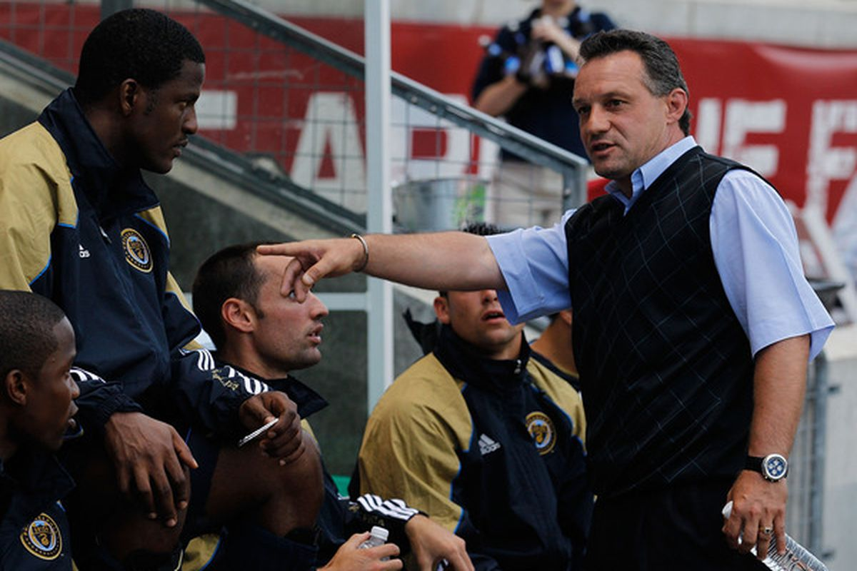 BRIDEVIEW, IL - JUNE 05: Head coach Peter Nowak of the Philadelphia Union talks to reserves on the bench before an MLS match against the Chicago Fire on June 5, 2010 at Toyota Park in Brideview, Illinois. (Photo by Jonathan Daniel/Getty Images)