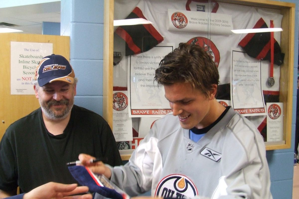 Captain Sweden signs an autograph.  © Lisa McRitchie, All Rights Reserved