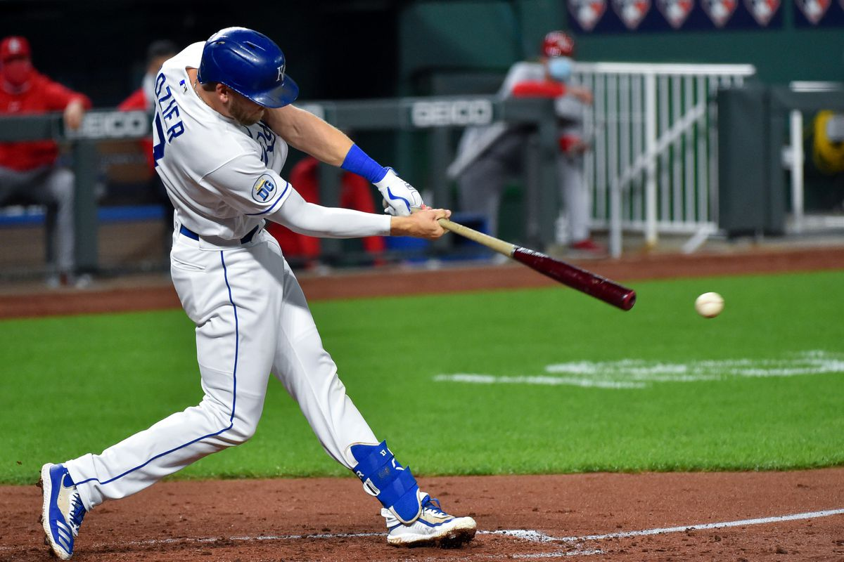 Hunter Dozier #17 of the Kansas City Royals hits a double in the fifth inning against the St. Louis Cardinals at Kauffman Stadium on September 21, 2020 in Kansas City, Missouri.