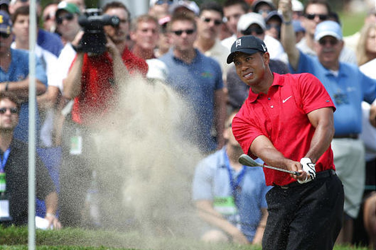 Tiger Woods hits out of the sand on the third hole during the final round of the Buick Open golf tournament Sunday at Warwick Hills in Grand Blanc, Mich.