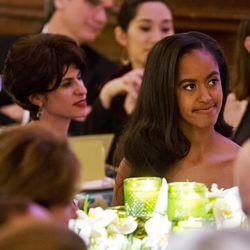 Malia Obama, right, next to actress Sandra Oh, left, listens as her father, President Barack Obama, receives a toast from Canadian Prime Minister Justin Trudeau during a State Dinner in the East Room of the White House in Washington, Thursday, March 10, 2016.