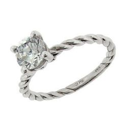 """Quite literally a twist on the traditional solitaire diamond ring, this affordable sparkler is just traditional enough. $670, <a href=""""http://www.stevequickjeweler.com/site/cart/productdetail.exc?cmd=view_cart_product&co_id=942&item_id=110061&prod_id=4968"""