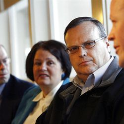 Bill Loveless, left, a delegate, his wife, Rhonda, and Jon VanderStek, a delegate, listen to Carl Wimmer, a candidate for the 4th Congressional District, at IHOP in West Jordan, Wednesday, April 4, 2012.