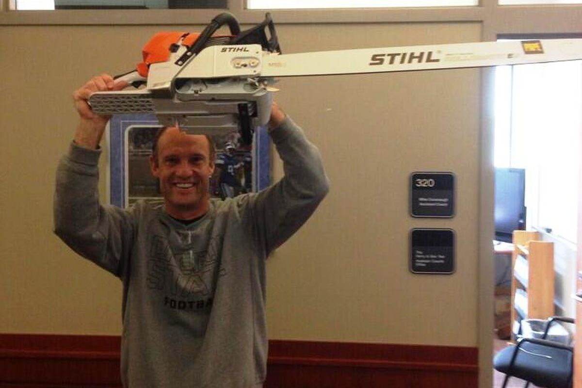 Coach Mike RIley is getting revved up for football! (Or a logging competition.)