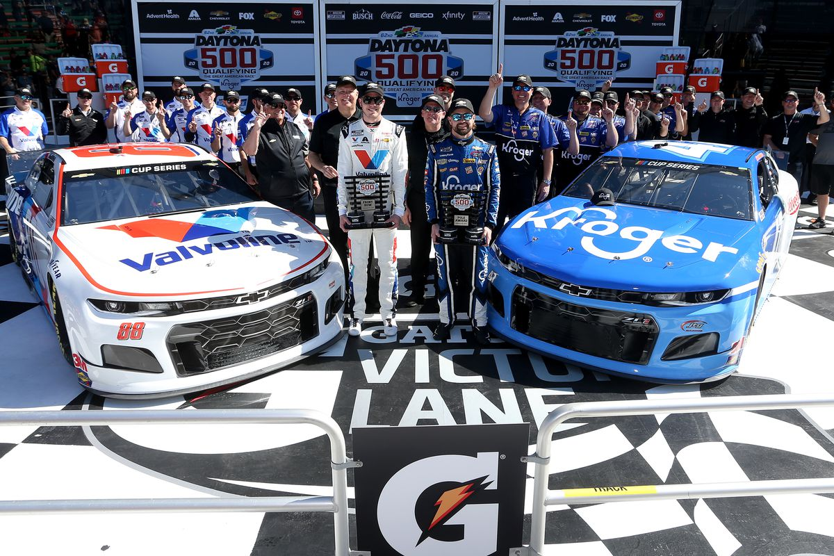 Ricky Stenhouse Jr., driver of the Kroger Chevrolet, and Alex Bowman, driver of the Valvoline Chevrolet, pose with the front row awards following qualifying for the NASCAR Cup Series 62nd Annual Daytona 500 at Daytona International Speedway on February 09, 2020 in Daytona Beach, Florida.