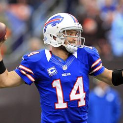 Buffalo Bills quarterback Ryan Fitzpatrick throws a 9-yard touchdown pass to wide receiver T.J. Graham in the first quarter of an NFL football game against the Cleveland Browns, Sunday, Sept. 23, 2012, in Cleveland.