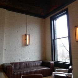 Leather couches and seats will overlook the massive windows upstairs.