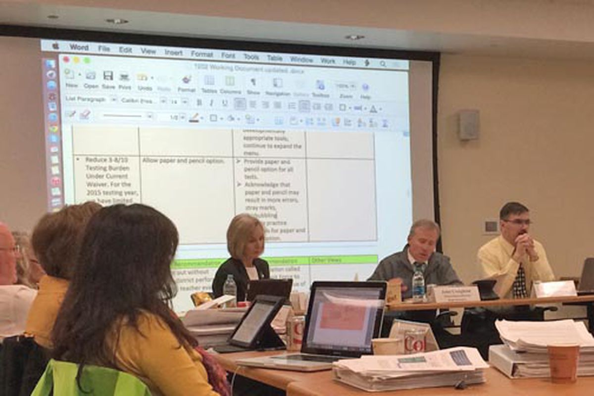 Members of Standards and Assessments Task Force slowly worked through their recommendations as changes were tracked in a document project on screens in the meeting room.