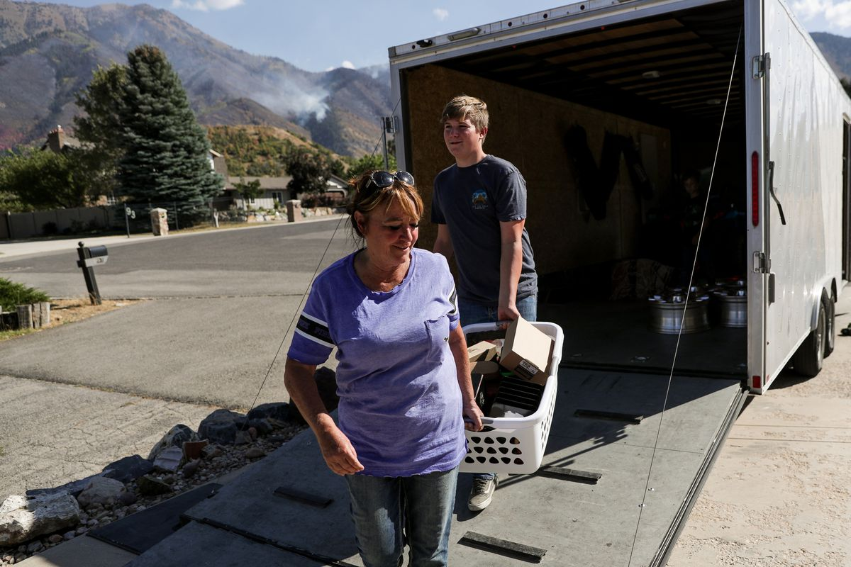 Gaylene Jacobson gets help from her grandson, Nash Peacock, 15, as she returns to her home in Elk Ridge after evacuations were lifted on Saturday, Sept. 22, 2018.   Gaylene Jacobson gets help from her grandson, Nash Peacock, 15, as she returns to her home in Elk Ridge after evacuations were lifted on Saturday, Sept. 22, 2018.