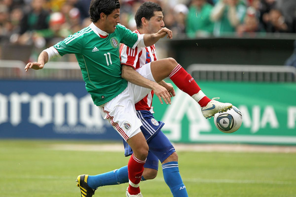 OAKLAND, CA - MARCH 26:  Carlos Vela of Mexico and Antolin Alcaraz of Paraguay go for the ball during their international friendly match at Oakland-Alameda County Coliseum on March 26, 2011 in Oakland, California.  (Photo by Ezra Shaw/Getty Images)