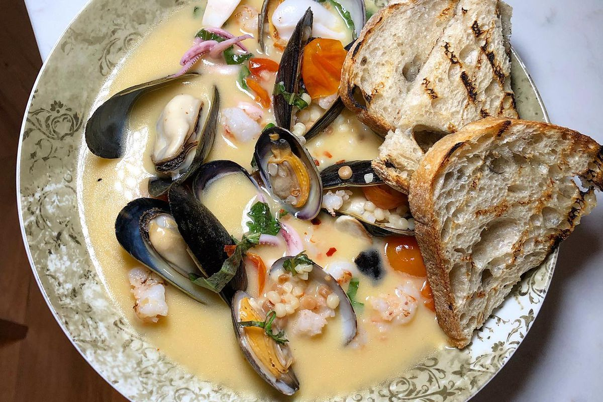 The fisherman stew with mixed shellfish, and cous cous in a lobster broth at La Strega.