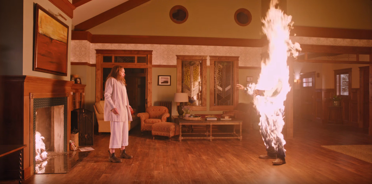 Toni Collette in Hereditary with a burning figure