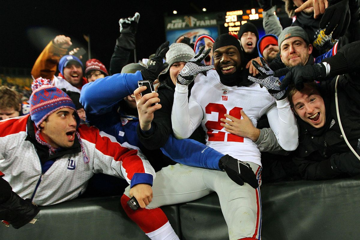 Kenny Phillips (21) of the New York Giants celebrates with the fans after defeating the Green Bay Packers during their NFC Divisional playoff game at Lambeau Field on January 15, 2012 in Green Bay, WI.  (Photo by Jamie Squire/Getty Images)