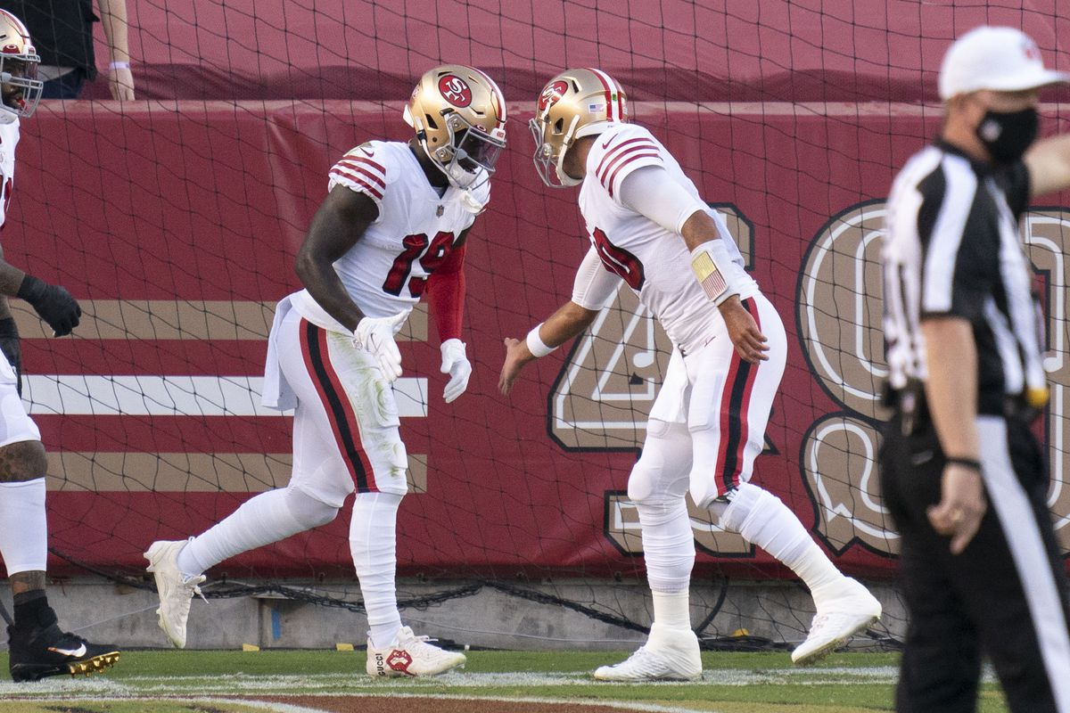 San Francisco 49ers wide receiver Deebo Samuel (19) is congratulated by quarterback Jimmy Garoppolo (10) for scoring a touchdown against the Los Angeles Rams during the first quarter at Levi's Stadium.
