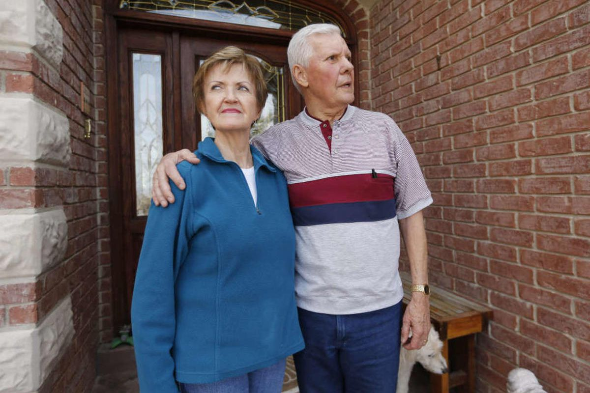 Vern Gillmore, recently diagnosed with Alzheimer's disease, stands with his wife Karen on the front porch of their home in Woodland Hills Wednesday, Feb. 4, 2015.