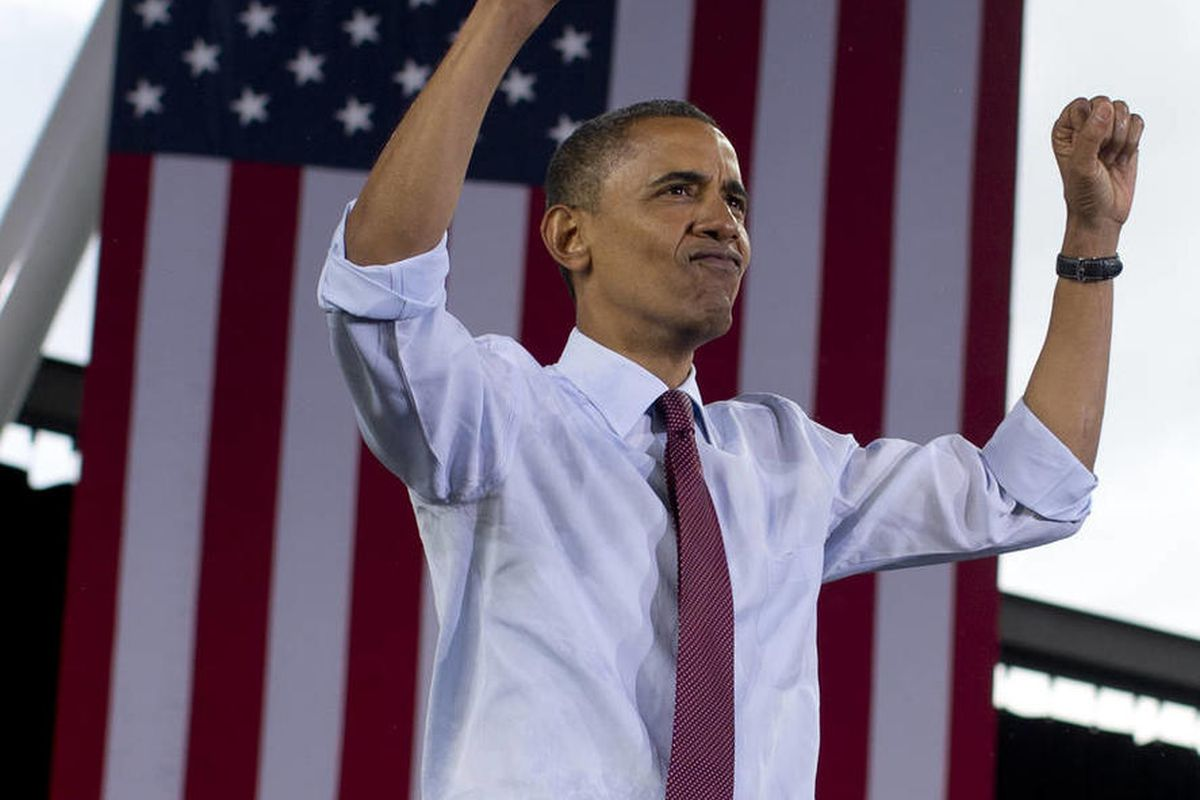 President Barack Obama holds up his fists to the crowd after speaking at the  Summerfest Grounds at Henry Maier Festival Park, Saturday, Sept. 22, 2012, in Milwaukee. (AP Photo/Carolyn Kaster)