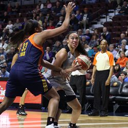 Connecticut Sun's Morgan Tuck (33) tries to prevent San Antonio Stars' Dearica Hamby (5) from getting to the basket.