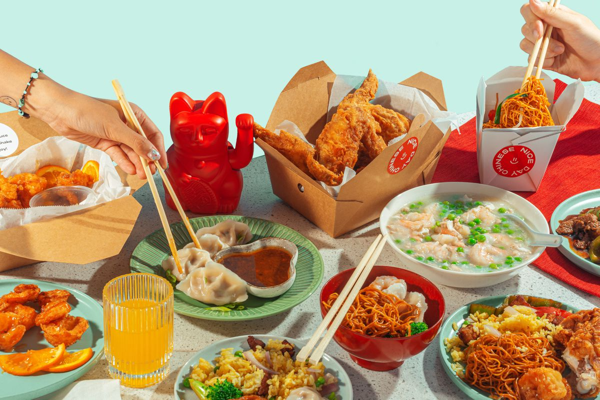 Several boxes of food lined up on a table with one pair of hands moving chopsticks over a box
