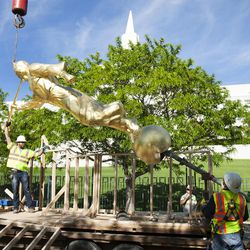 The new Angel Moroni statue is lifted by a crane in Bountiful on Wednesday, June, 1, 2016.
