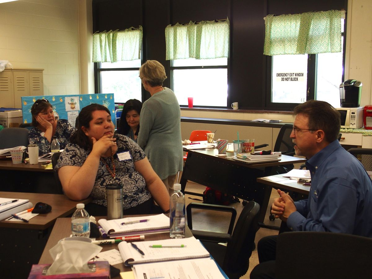 Kingsbury Elementary School teachers and staff, including two new teacher assistants hired under new funds from student-based budgeting in Shelby County Schools, receive training.