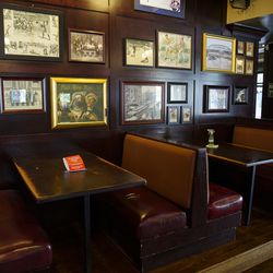 Booths and framed photos and art at Southport Lanes in Lake View.