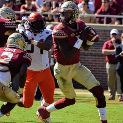 FR QB James Blackman roles out of the pocket against Syracuse.