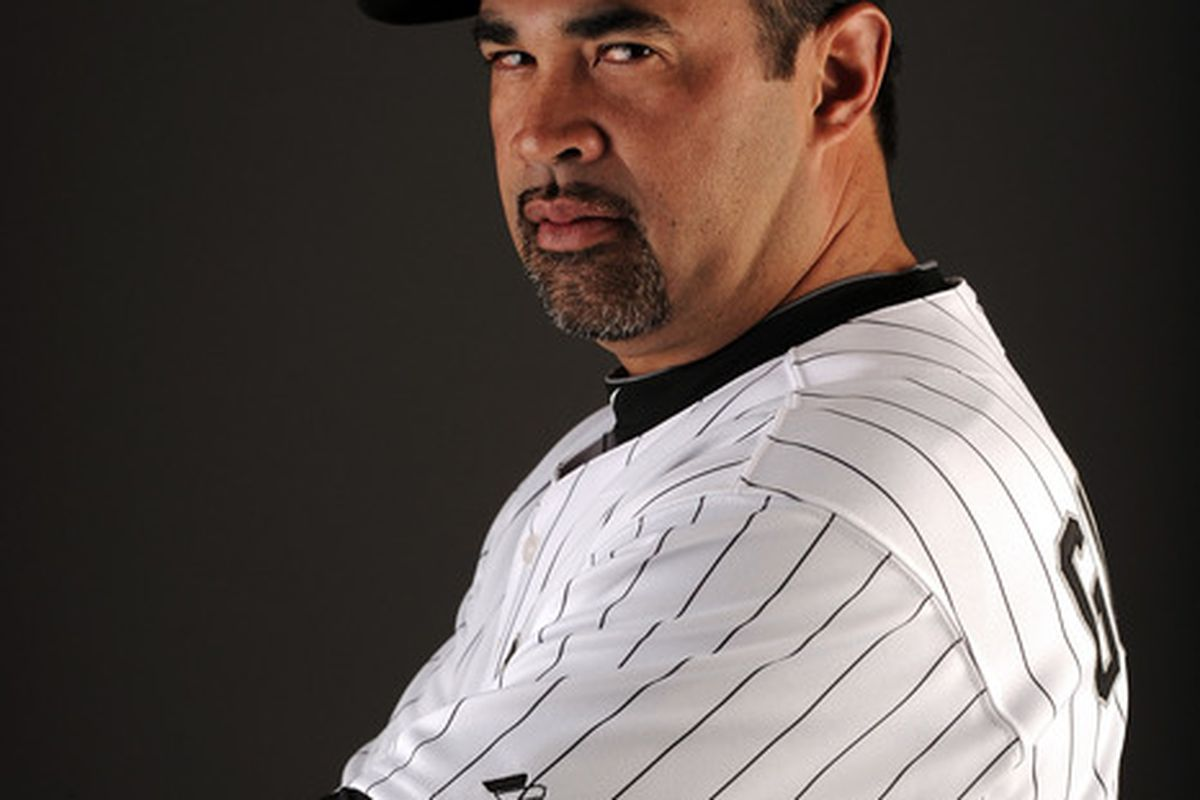 Chicago White Sox manager Ozzie Guillen sees you, Bobby Jenks. And, believe you me, he's none too pleased. (Photo by Harry How/Getty Images)