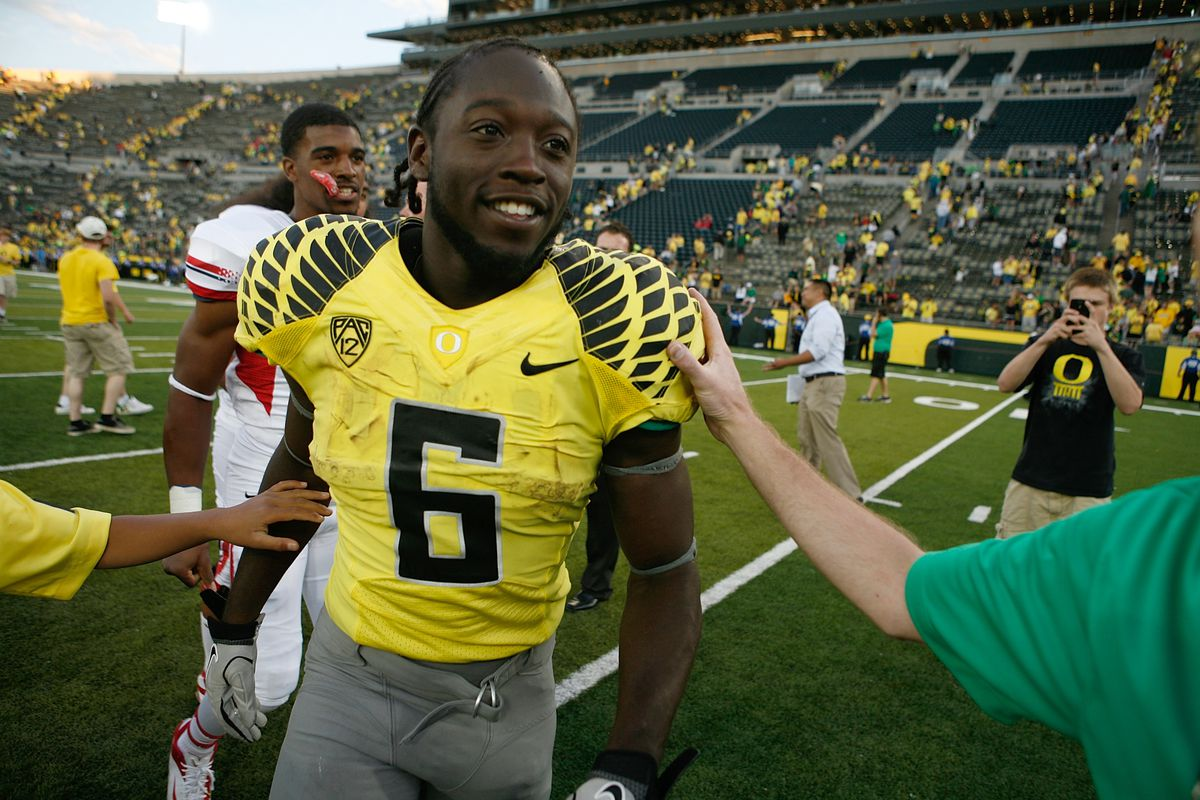 De'Anthony Thomas is smiling because he scores every 2-3 times he touches the ball.  No, really.