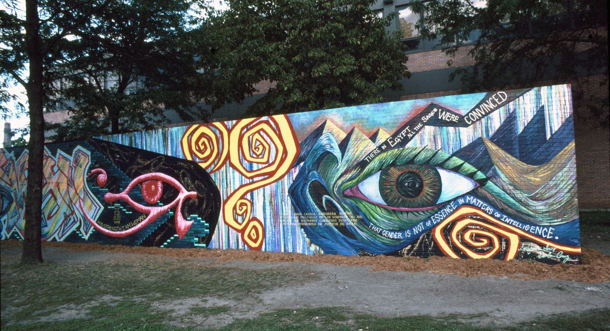 """Olivia Gude's mural """"Aren't I a Womyn?"""" at 1147 N. Western Ave. features a large eye and abstract elements alongside text."""