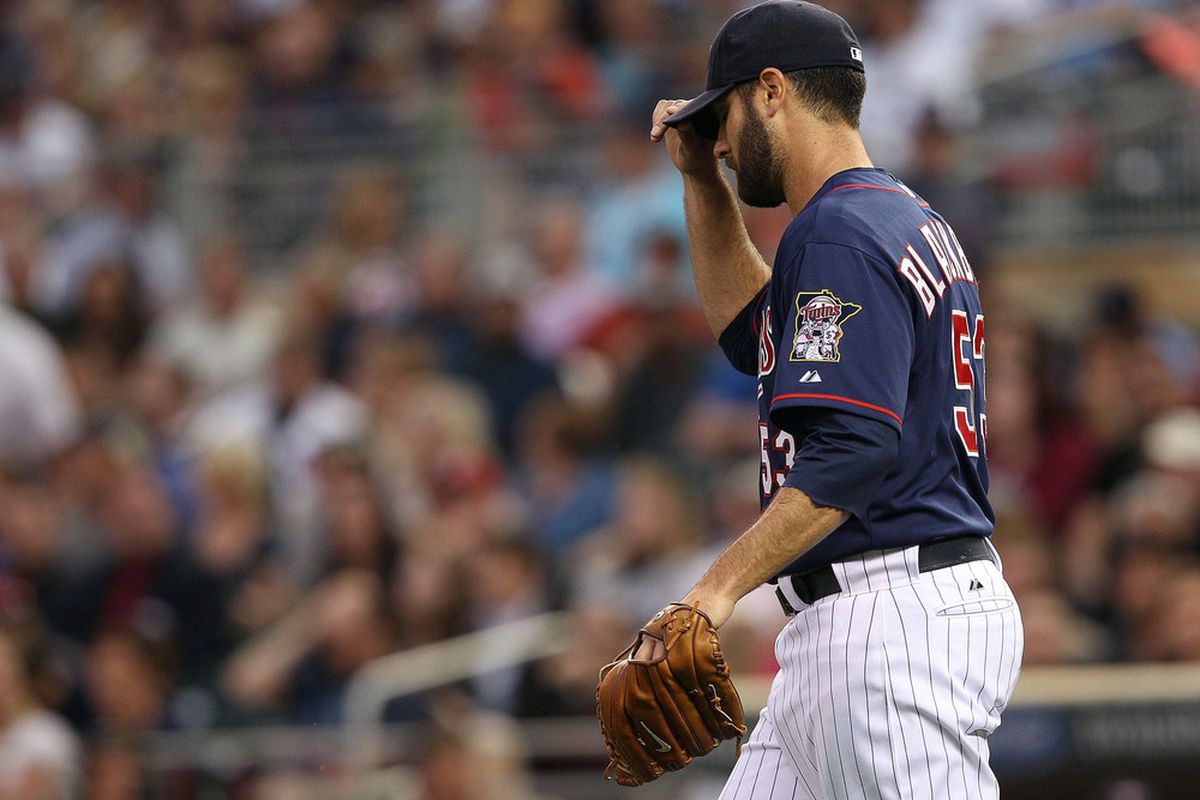 Apr 24, 2012; Minneapolis, MN, USA: Minnesota Twins starting pitcher Nick Blackburn (53) walks off the mound during the first inning against the Boston Red Sox at Target Field. Mandatory Credit: Jesse Johnson-US PRESSWIRE