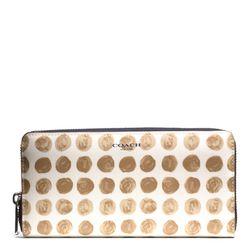 "<a href=""http://f.curbed.cc/f/Coach_031014_BleeckerDot"">Bleecker Accordion Zip Wallet in Silver/Tan Mutli Painted Dot Canvas</a>, $188"