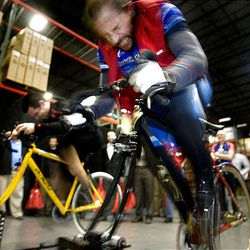 Mark Albrecht, right, and Tony Brisindi, left, compete in a gold sprint stationary bike race during the grand opening of Specialized Bicycle\\\'s 250,000-square-foot warehouse and distribution center in West Valley City Thursday.