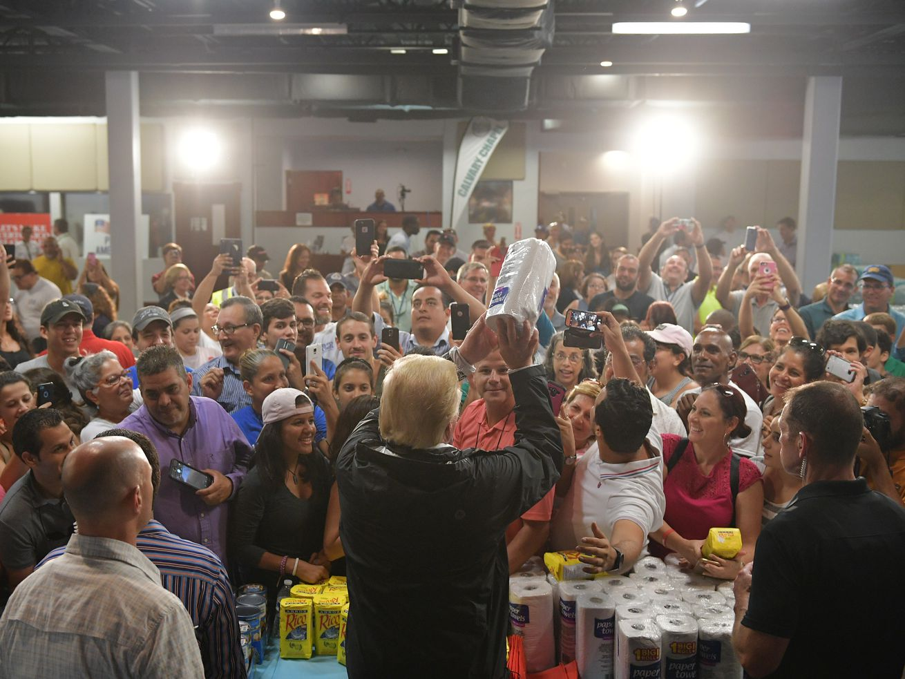 Trump tossing paper towels into a crowd in Puerto Rico.