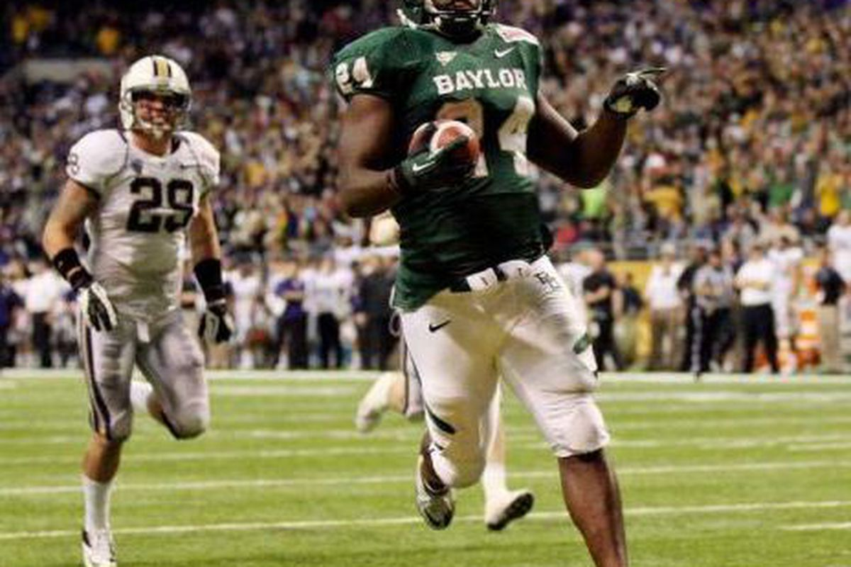 Baylor's Terrance Ganaway ran for 200 yards, and 5 second half touchdowns, to lead the Bears to a 67-56 win over Washington in the Valero Alamo Bowl. <em>(San Antonio Express Photo)</em>