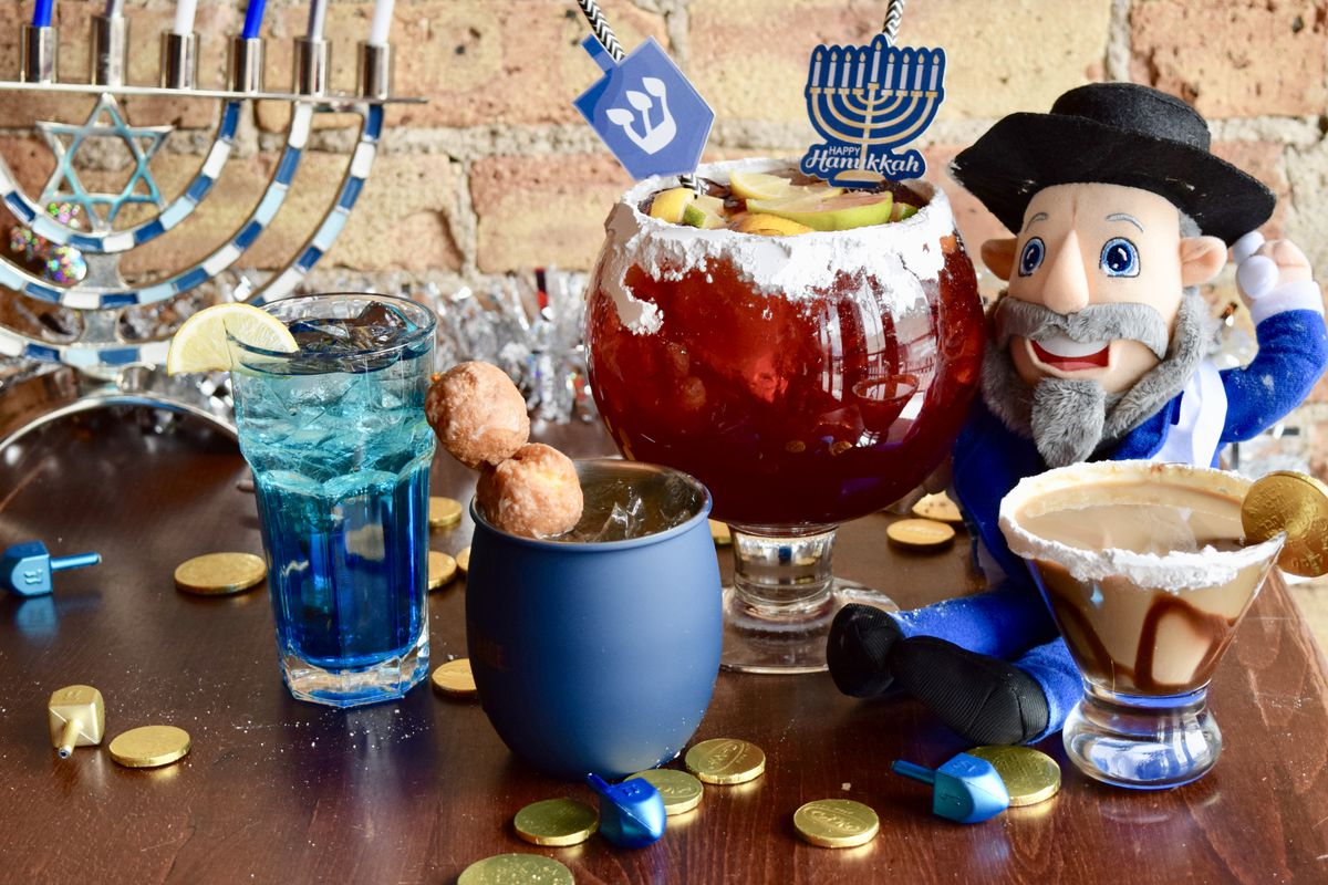 A table with several drinks and Hanukkah gelt sprinkled around.