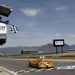 Romain Dumas brings the P2 Porsche RS Spyder across the finish line for the win in the Round 4 American Le Mans Series at the Larry H. Miller Dealerships Utah Grand Prix at Miller Motor Sports Park in Tooele on May 18, 2008.