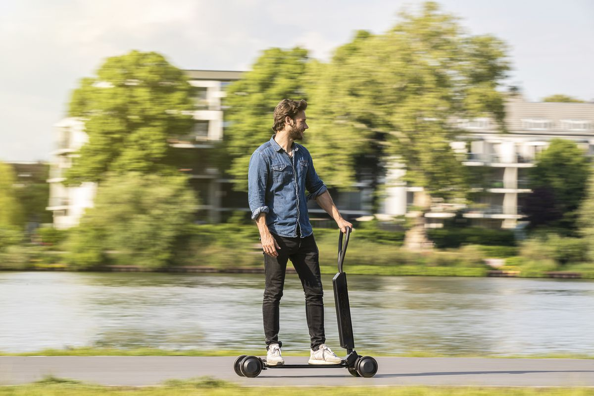 Audi has combined an electric scooter and a skateboard into one