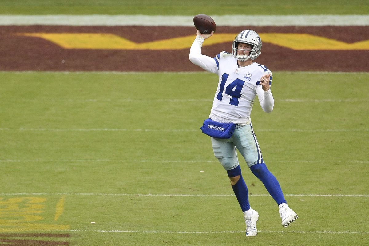 Andy Dalton #14 of the Dallas Cowboys throws a pass in the third quarter against the Washington Football Team at FedExField on October 25, 2020 in Landover, Maryland.