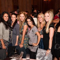"""Expect to find some classy women at a Day and Night brunch like these ones who went to one of the few held at the Oak Room, although they aren't wearing the """"brightly colored dresses or skirts"""" that the article recommends."""