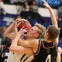 Orem's Taylor Hockersmith and British Columbia Christian Panthers' Filip Milosevic fight for the rebound during a Vivint Great Western Shootout basketball game at Orem High School in Orem on Friday, Dec. 8, 2017. Orem won 63-56.