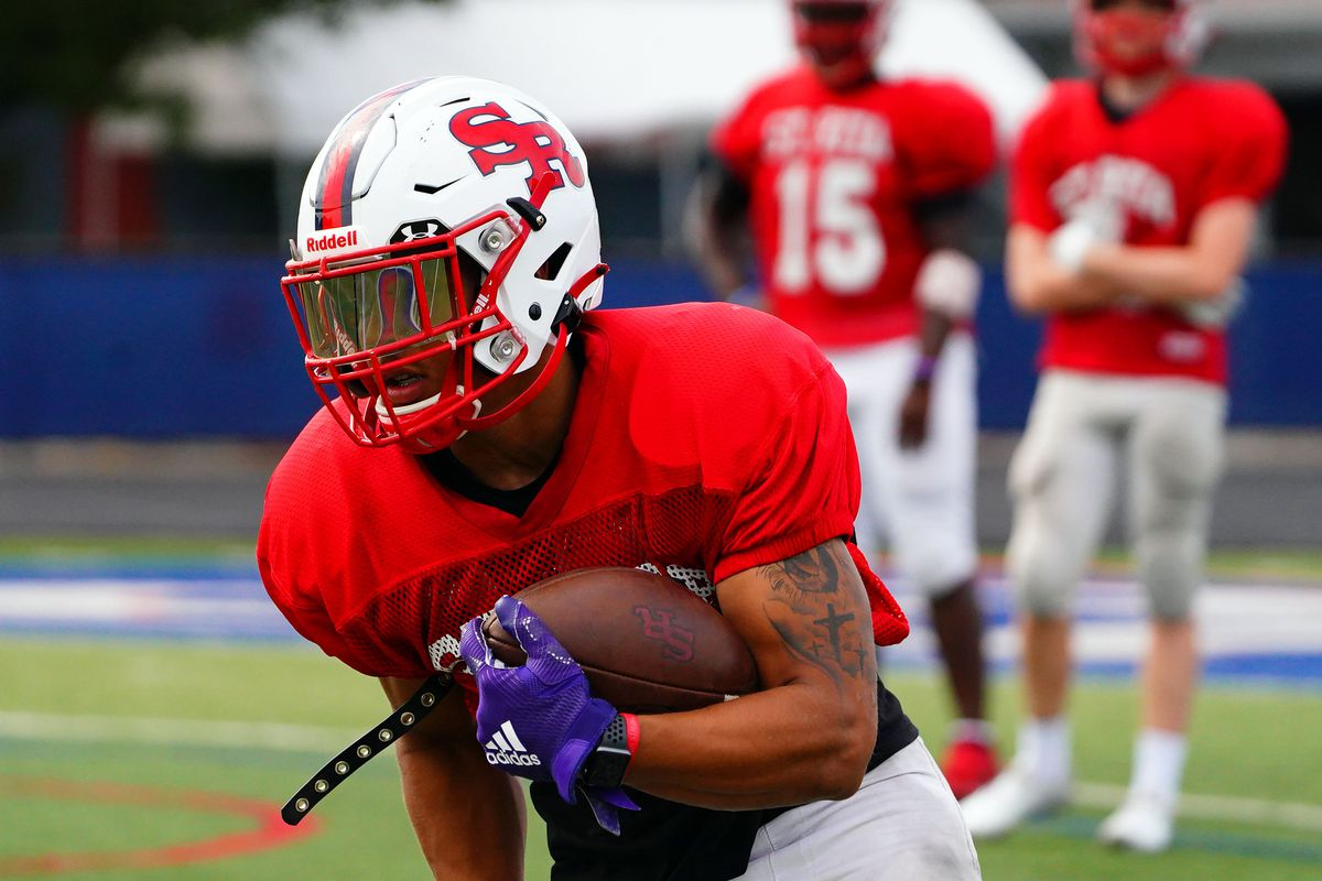 St. Rita's Kaleb Brown (3) moves the ball downfield at practice, Monday, August 23, 2021.