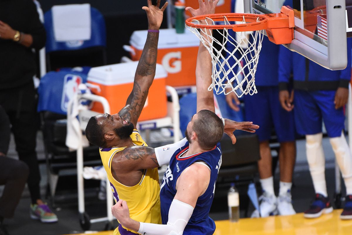 LeBron James #23 of the Los Angeles Lakers shoots the ball against the LA Clippers during a game on December 22, 2020 at STAPLES Center in Los Angeles, California.