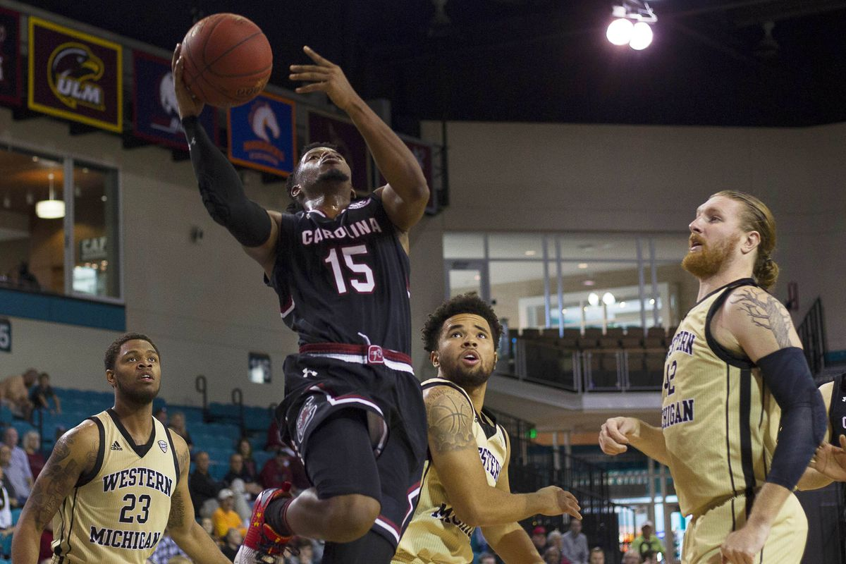 Nov 19, 2017; Conway, SC, USA; South Carolina Gamecocks guard Wesley Myers (15) goes in for the layup while being defended by Western Michigan Broncos center Drake LaMont (42) during the first half of the game at HTC Center. South Carolina Gamecocks won 79-66. Mandatory Credit: Joshua S. Kelly-USA TODAY Sports