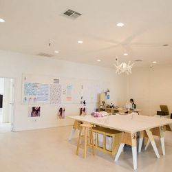 """<a href=""""http://la.racked.com/archives/2014/08/15/inside_statesides_clean_and_cool_dtla_studio.php""""><b>Stateside</b></a>'s clean and cool workspace."""