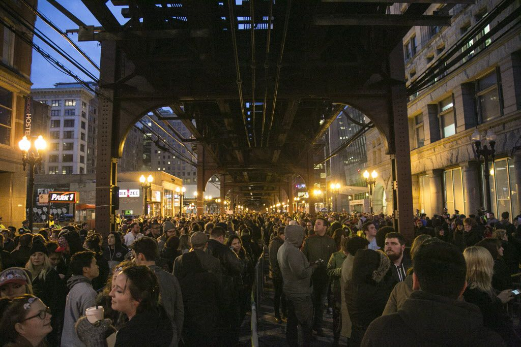 """Thousands wait in line outside the Auditorium Theatre for Bernie Sanders' """"A Future to Believe In Chicago Rally,"""" on Monday night. 