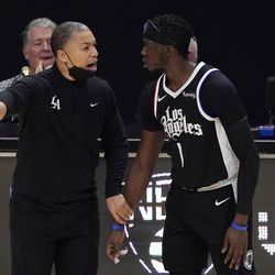 Los Angeles Clippers head coach Tyronn Lue, left, talks with guard Reggie Jackson during the second half of Game 3 of a second-round NBA basketball playoff series against the Utah Jazz Saturday, June 12, 2021, in Los Angeles.