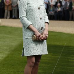 Showing a teeny baby bump on April 21st, 2013 in a Mulberry coat and L.K. Bennett heels.