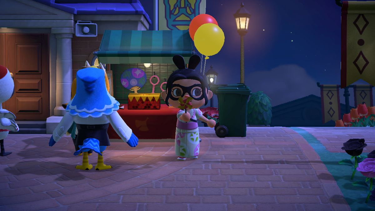An Animal Crossing character blows on a Pinwheel