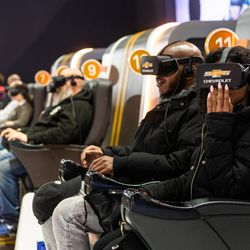 Attendees of the 2020 Chicago Auto Show Saturday at McCormick Place experience riding in Chevrolet at the automaker's virtual reality exhibit.