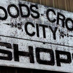 Paint is weathered on the original Woods Cross shop sign at Woods Cross Public Works on Tuesday, Aug. 9, 2016.